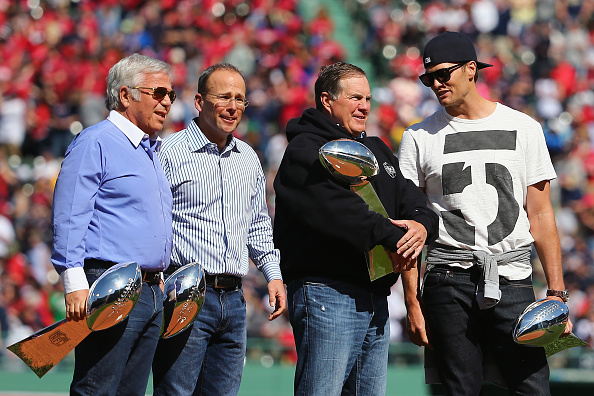 Owner Robert Kraft, President Jonathan Kraft, Coach Bill Belichick, and QB Tom Brady