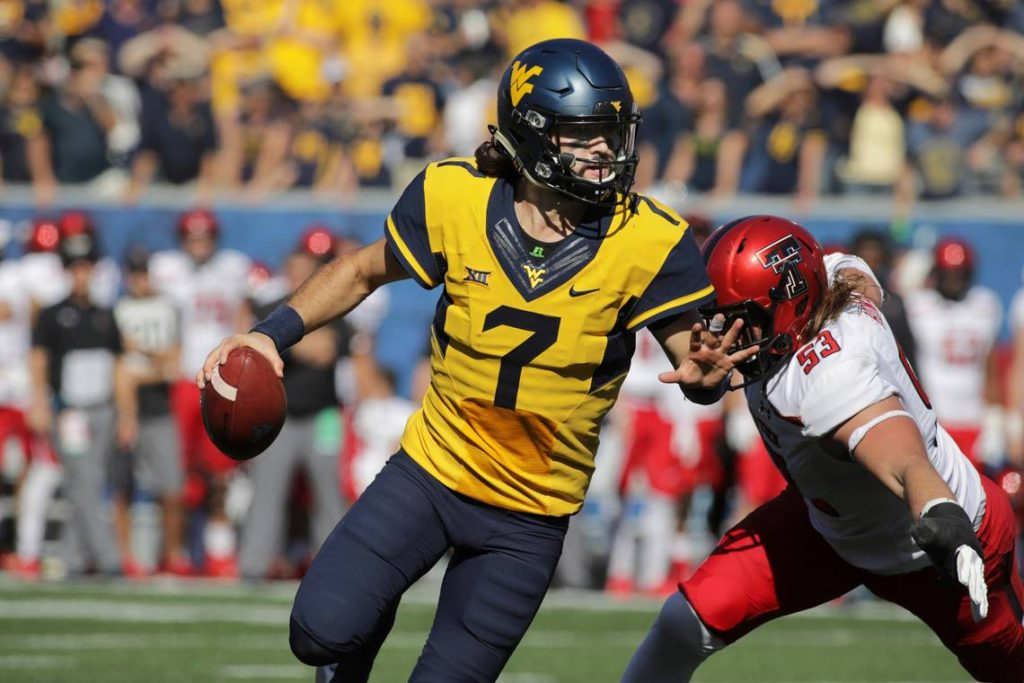 Will Grier playing Texas Tech during his time at West Virginia.